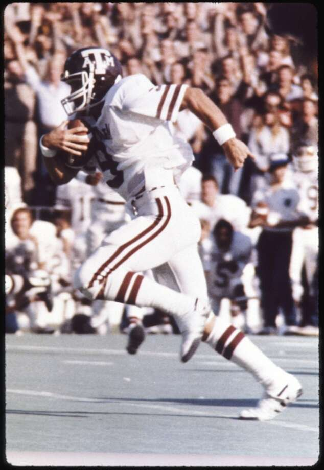 Gary Kubiak runs with the ball during his days as a quarterback at A&M. Photo: File Photo