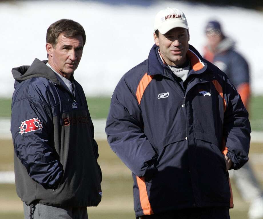 Gary Kubiak watches the Broncos with coach Mike Shanahan, left, during practice Jan. 20, 2006, before the AFC Championship Game. Kubiak served as a Broncos  assistant for 11 seasons. Photo: Ed Andrieski, Associated Press