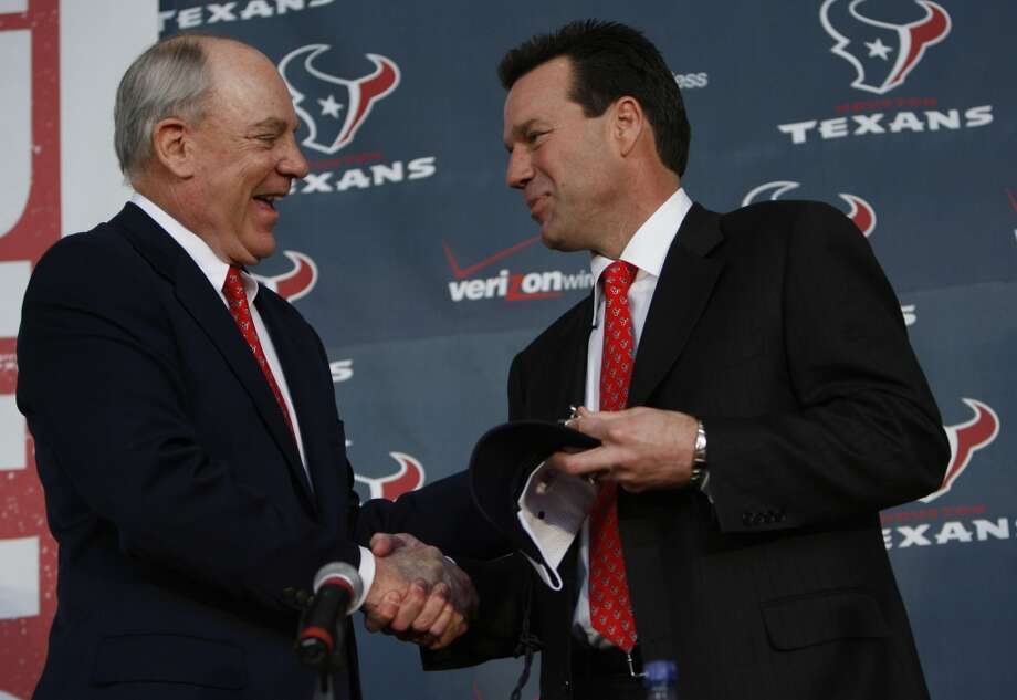 Gary Kubiak is introduced as the second head coach in Texans history on Jan. 26, 2006. Team owner Bob McNair shakes Kubiak's hand during the introductory news conference. Photo: Karen Warren, Houston Chronicle