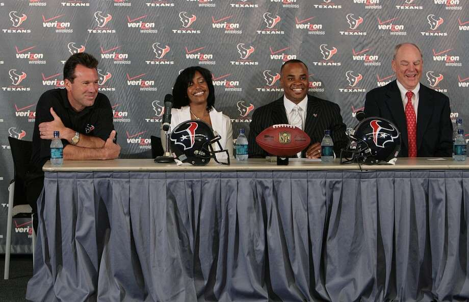 From left to right: Gary Kubiak, Tiffany Smith, general manager Rick Smith and owner Bob McNair attend the news conference to officially announce Rick Smith as the team's new GM on June 5, 2006. Photo: Mayra Beltran, Houston Chronicle