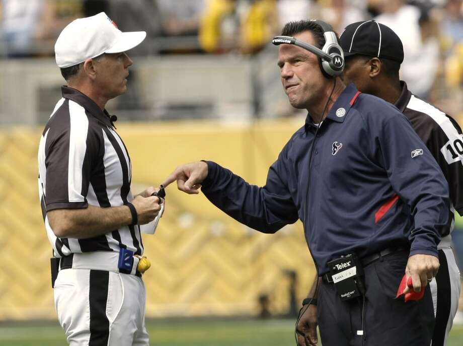 Gary Kubiak argues a spot call with referee Terry McAulay, left, during the first quarter of the Texans' 38-17 2008 season-opening loss to the Pittsburgh Steelers. Photo: Brett Coomer, Houston Chronicle