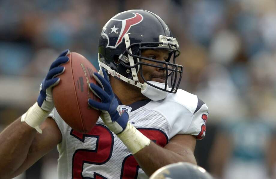"Texans running back Chris Brown throws the infamous ""halfback pass"" which was intercepted in the fourth quarter of the Texans'  23-18 loss to the Jacksonville Jaguars on Dec. 6, 2009. The play call was one of the most scrutinized decision's of Kubiak's tenure with the Texans. Photo: Stephen Morton, Associated Press"