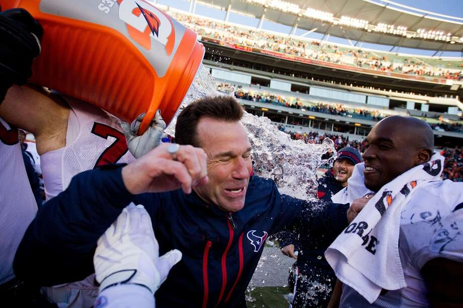 Gary Kubiak receives a Gatorade bath after the Texans rallied to score in the final minute to beat the Cincinnati Bengals 20-19 on Dec. 11, 2011. With the victory, the Texans clinched their first  postseason berth and first AFC South division title in franchise history. Photo: Smiley N. Pool, Houston Chronicle