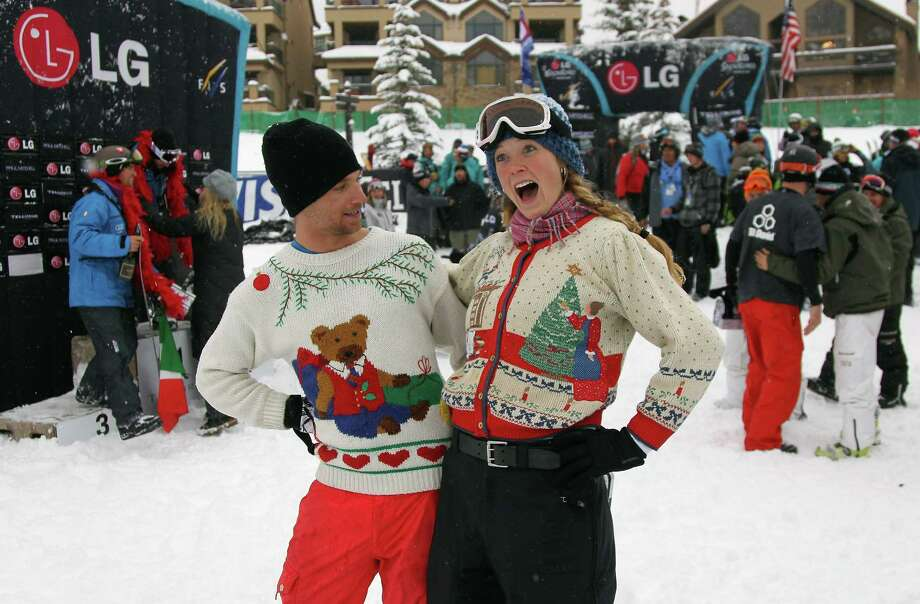 This is how it is done. Ugly sweater. Snow. Fun. Jayson Hale of the U.S. Snowboard Team and Kaylin Richardson, retired U.S. Alpine Skier, show off their Christmas sweaters. Photo: Doug Pensinger, Getty Images / 2010 Getty Images