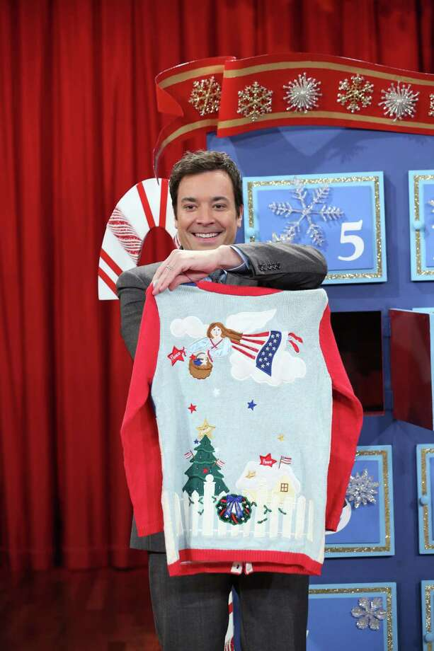Jimmy Fallon wins ugly sweater, thanks to an angel wearing an American flag. Photo: NBC, Getty Images / 2012 NBCUniversal Media, LLC