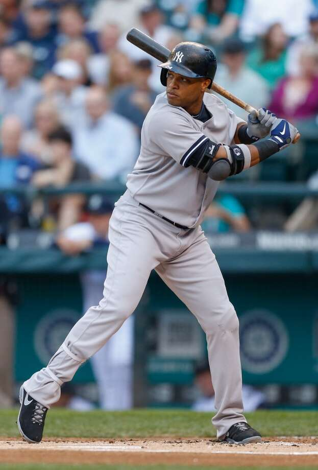 Robinson Cano may be coming to Seattle. Here's a look at him in Yankee pinstripes at Safeco Field on June 6, 2013. (Photo by Otto Greule Jr/Getty Images) Photo: Otto Greule Jr, Getty Images
