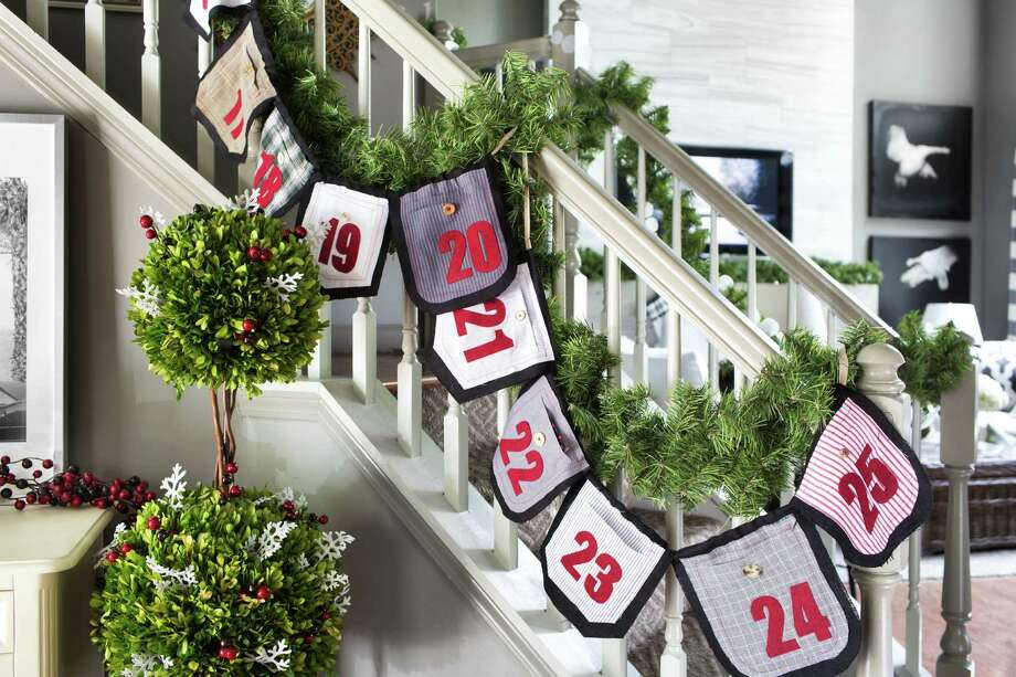 Designer Brian Patrick Flynn used swatches of men's shirt fabrics to create a garland that also serves as an advent calendar. Photo: HGTV Photos