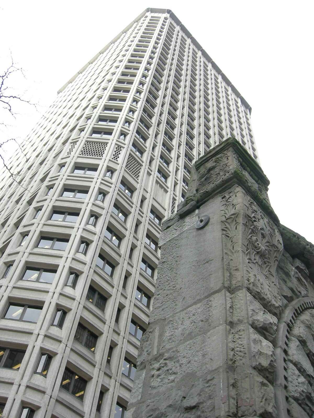 """The Henry M. Jackson Federal Building, in Downtown Seattle (1974). The foreground shows part of the main arch of the Burke Building, which used to stand there. Bassetti told HistoryLink.org that the original design featured a brick exterior, which """"unfortunately got value-engineered out as too costly."""""""