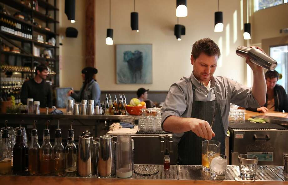 Bartender Jason Beaudrow mixes drinks at Alta CA, the new San Francisco restaurant from Daniel Patterson (rear left). The restaurant is a block from Twitter headquarters on Market Street. Photo: Lea Suzuki, The Chronicle