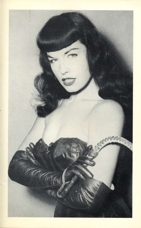 """Known as the """"Queen of Pinups,"""" Page's black bangs and risqué photos came to represent a popular look of the 1950s. Photo: Courtesy """"Bettie Page Reveals All"""", Music Box Films"""