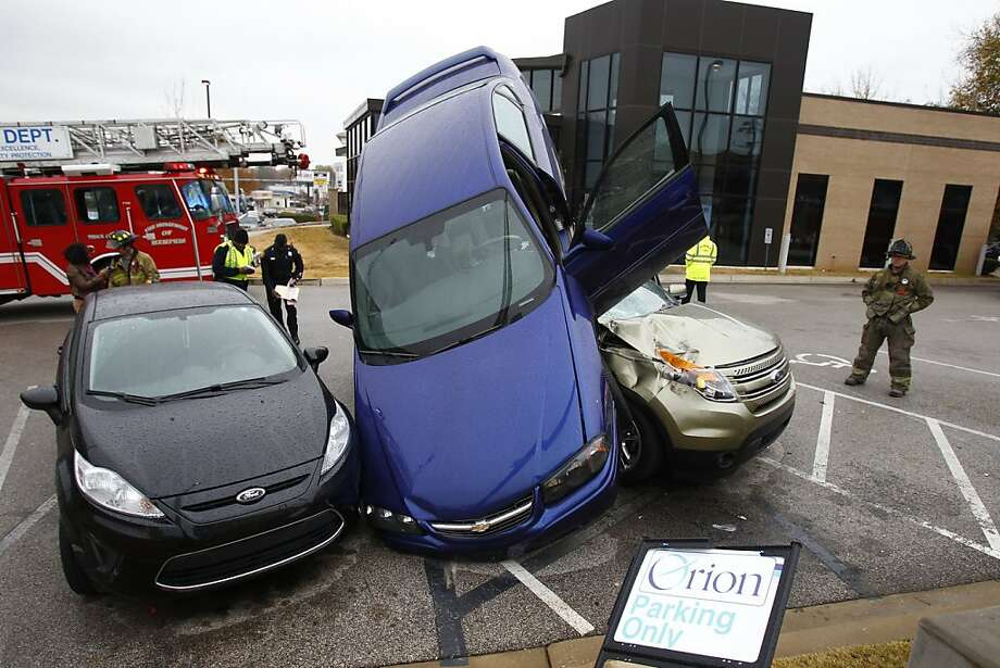 Orion Credit Union now accepting new-car loan applications: In Memphis, a 26-year-old motorist backing out of a parking space of a Panera Bread restaurant drove off the elevated lot and fell on top of two cars parked in the adjacent parking lot of the Orion Credit Union. No one was injured. Photo: Mark Weber, Associated Press