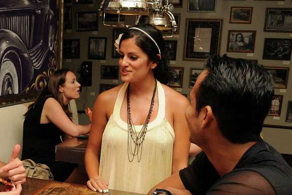 Waitress Christine Garza helps Jeff Brock and Rene Quintanar at Prohibition in the Galleria  Saturday Aug. 06,2011.