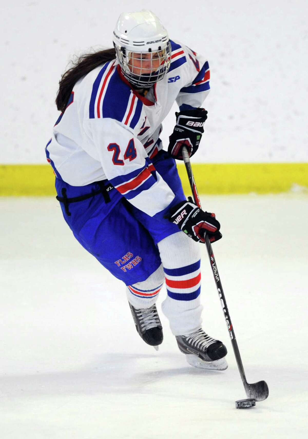 Fairfield Warde/Ludlowe's Gabby Bochenczyk controls the puck during their ice hockey game against Notre Dame-Fairfield at Wonderland of Ice in Bridgeport, Conn. Wednesday, Feb. 20, 2013.
