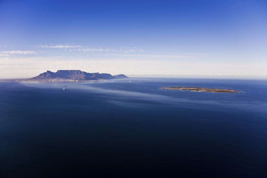 Cape Town's iconic Table Mountain can be seen from a distance on Robben Island. Home to the infamous Robben Island Prison, where Mandela spent almost two decades, the Island is 6.9 miles off the coast of mainland South Africa. Photo: Courtesy Of Great Safaris, Getty Images/iStockphoto