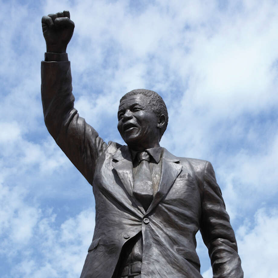 A statue of Nelson Mandela stands outside Drakenstein Correctional Centre near Franschoek, South Africa, where he was released on Feb. 11, 1990, after 27 years of  incarceration. A 9-foot replica stands outside South Africa's embassy in Washington, D.C., funded in part by the owners of the Travel Corp., whose African Travel Inc. subsidiary began a Mandela-themed tour in February. Photo: LatitudeStock - David Forman, Getty Images/Gallo Images / Gallo Images