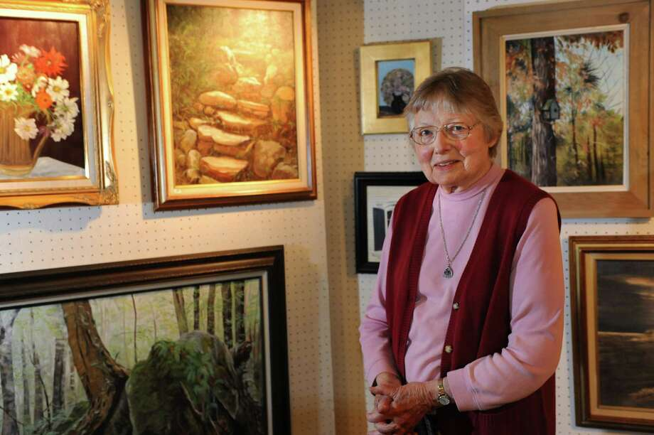 Marjorie Sack Hobday presents some of her paintings on Thursday, Dec. 5, 2013, at her home in Burnt Hills, N.Y. (Cindy Schultz / Times Union) Photo: Cindy Schultz / 00024891A