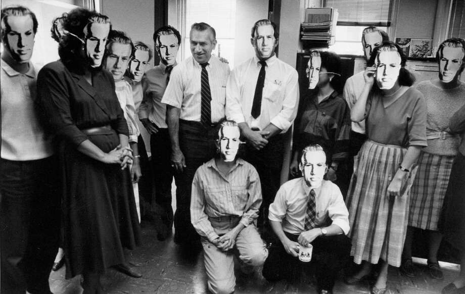 San Antonio Light city editor Ben Siegal was serious about enforcing standards. Above, colleagues wearing their Siegal masks pose with him. Siegal spent three decades at the Light. Photo: Courtesy Randall K. Roberts