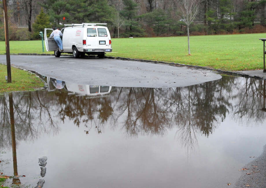 A flooded Bruce Park Drive, in Bruce Park, Greenwich, Dec. 12, 2008. Photo: Bob Luckey / Greenwich Time