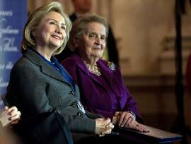 Former US Secretaries of State Hillary Clinton (L) and Madeleine Albright listen to a speaker after Clinton received the 2013 Lantos Human Rights Prize during a ceremony on Capitol Hill in Washington on December 6, 2013.   AFP PHOTO/Nicholas KAMMNICHOLAS KAMM/AFP/Getty Images