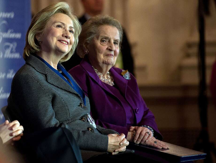 Former US Secretaries of State Hillary Clinton (L) and Madeleine Albright listen to a speaker after Clinton received the 2013 Lantos Human Rights Prize during a ceremony on Capitol Hill in Washington on December 6, 2013.   AFP PHOTO/Nicholas KAMMNICHOLAS KAMM/AFP/Getty Images Photo: Nicholas Kamm, AFP/Getty Images