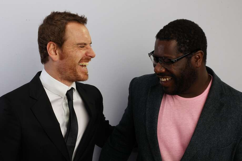 LONDON, ENGLAND - OCTOBER 14: Actor Michael Fassbender (L) and Director Steve McQueen poses during the 'Shame' portrait session at Vue West End on October 14, 2011 in London, England. (Photo by Dave J Hogan/Getty Images For The BFI)