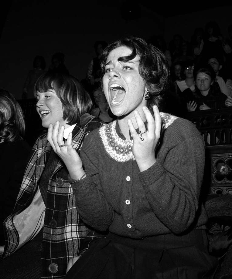 The Beatles 1964 US Tour, A screaming American music fan is gripped by Beatlemania as the band perform on stage at Carnegie Hall, New York during their tour of America  (Photo by Popperfoto/Getty Images) Photo: Popperfoto/Getty Images