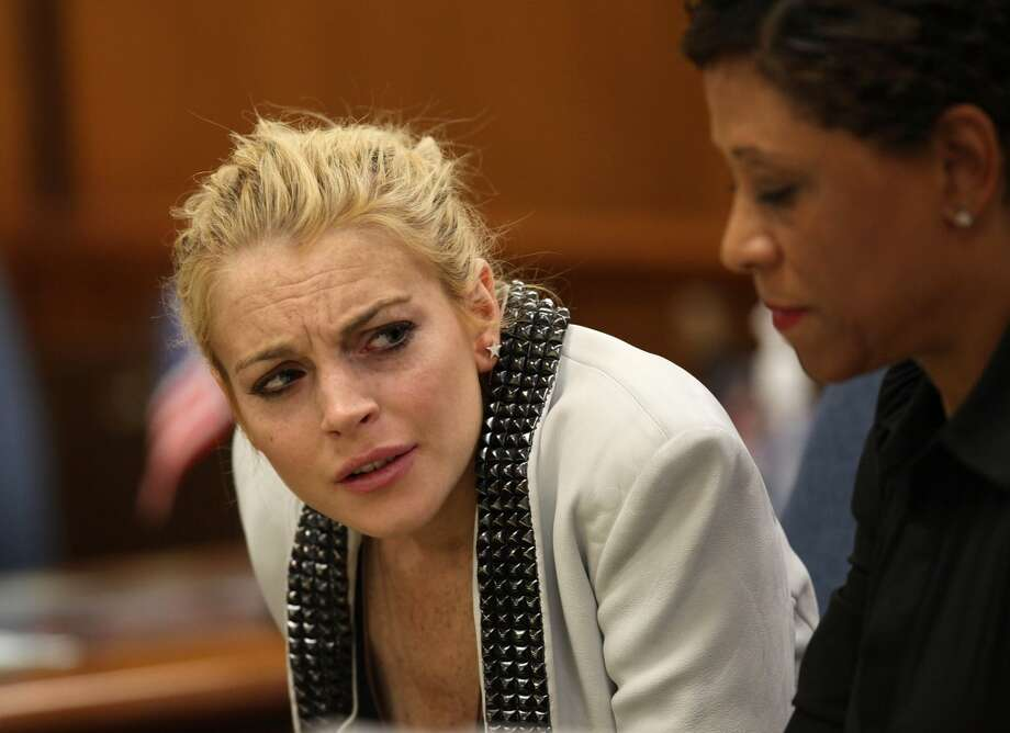 BEVERLY HILLS, CA - OCTOBER 16:  Actress Lindsay Lohan attends a court hearing at Beverly Hills Municipal Court on October 16, 2009 in Beverly Hills, California. Lohan was ordered to appear in court for a progress report on her 2007 drunk driving case.  (Photo by Nick Ut-Pool/Getty Images) Photo: Getty Images