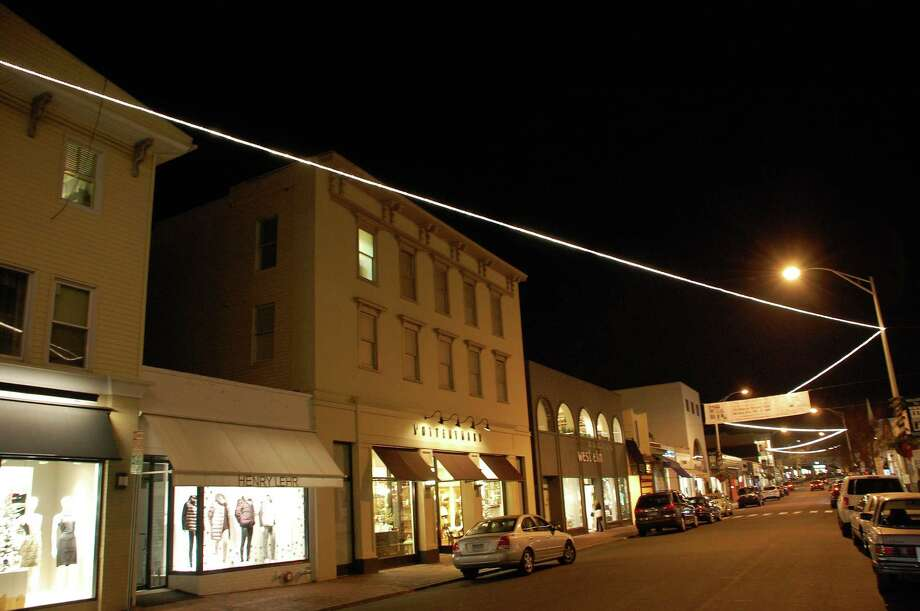 Lacking trees to string up holiday lights along Main Street downtown as in years past, a new zigzag pattern of lights overhangs the thoroughfare. Photo: Jarret Liotta / Westport News contributed