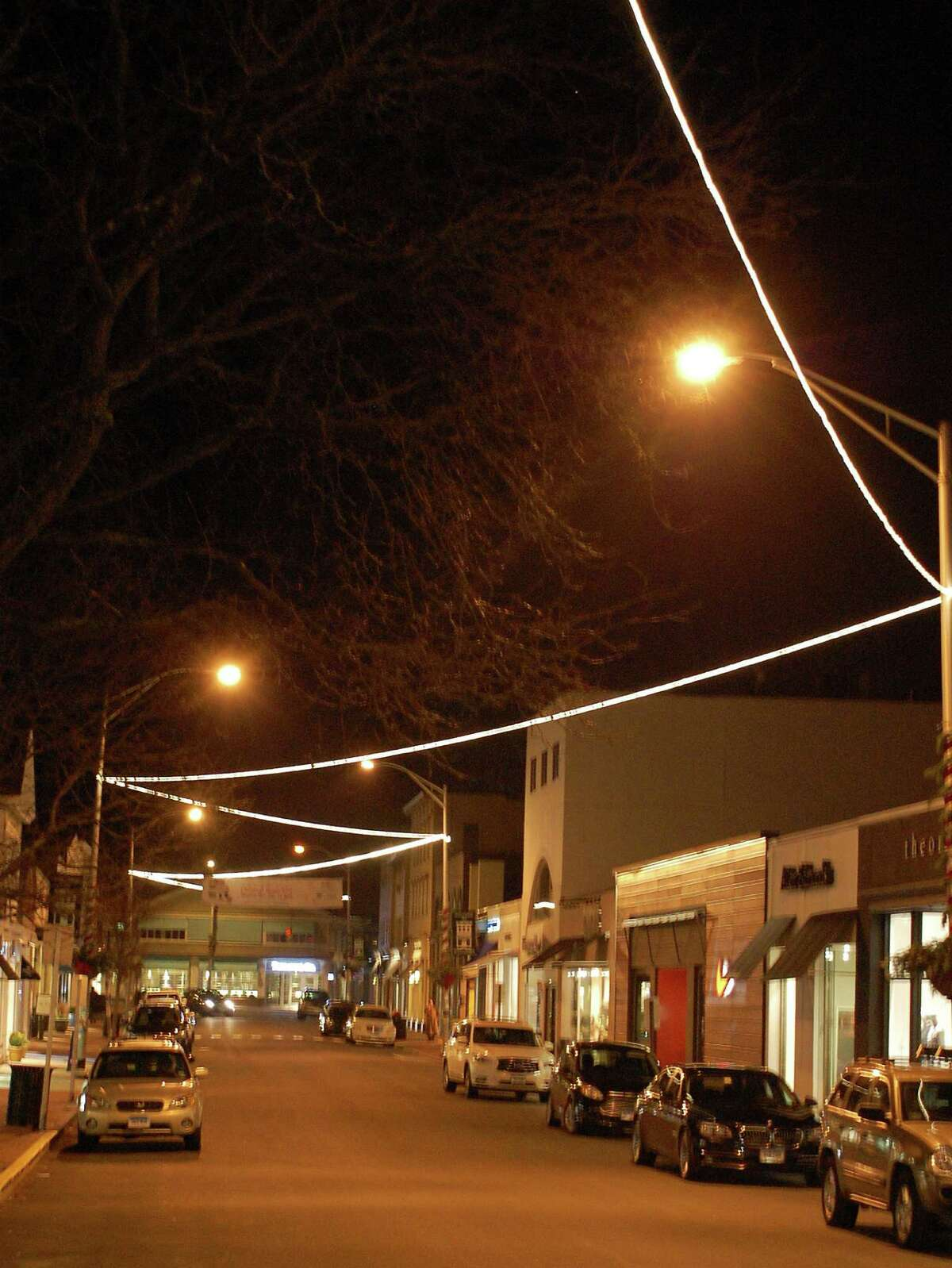 Lacking trees to string up holiday lights along Main Street downtown as in years past, a new zigzag pattern of lights overhangs the thoroughfare.