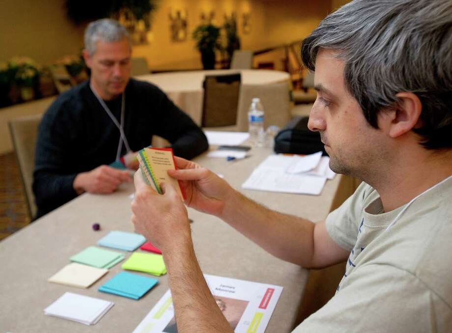 Larry DeLucas, right, and Rob Brinkman, left, play-test Liberty at the Stamford Sheraton during AnonyCon, a game convention, in Stamford, Conn., on Friday, December 6, 2013. The convention continues through the weekend and ends Sunday, December 8, 2013. Photo: Lindsay Perry / Stamford Advocate