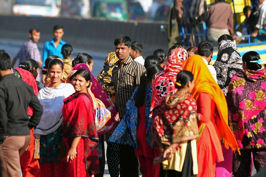 Bangladeshi garment workers walk out from a factory in Gazipur, a garment manufacturing hub outside Dhaka in protest over poor wages and working conditions. Their minimum pay was raised to $67 a month. Photo: Munir Uz Zaman, AFP/Getty Images