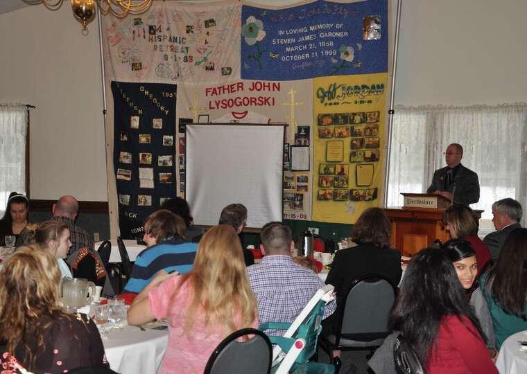 Fulton-Montgomery Community College President Dustin Swanger speaks at the World AIDS Day Breakfast