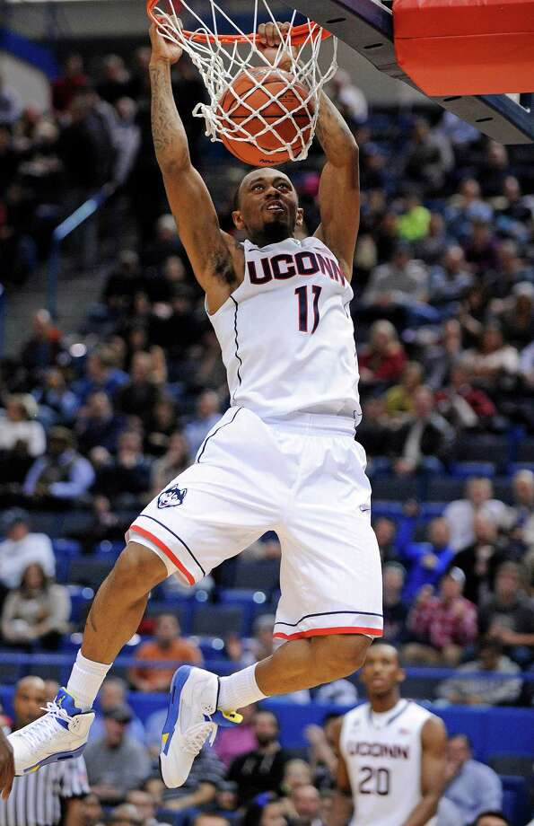 Connecticut's Ryan Boatright (11) scores two of his team-high 17 points during the first half of Connecticut's 95-68 victory over Maine in an NCAA college basketball game, in Hartford, Conn., on Friday, Dec. 6, 2013. Photo: Fred Beckham, AP / Associated Press