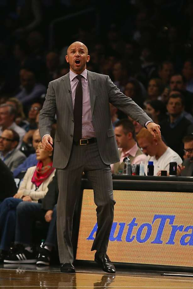 Jason Kidd, left, conveniently spilled a drink after running out of timeouts. Photo: Al Bello, Getty Images