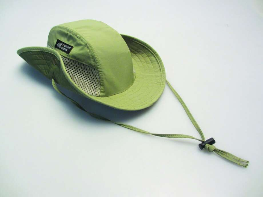 Academy's lightweight Magellan hiking hat has cooling mesh panels inset and is made of fabric with sun protection ($14.99). Photo: Terry Scott Bertling, San Antonio Express-News