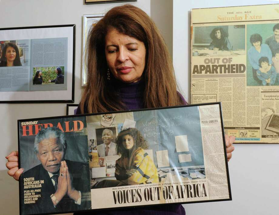 "Albany Law School Dean Penelope ""Penny"" Andrews holds a framed Sunday Herald article about Nelson Mandela in her office at the school Friday, Dec. 6, 2013 in Albany, N.Y. (Lori Van Buren / Times Union) Photo: Lori Van Buren / 00024948A"