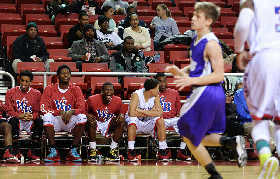 West Brook players watch their teammates play against Port Neches-Groves on Friday. The West Brook High School boys basketball team played against Port Neches-Groves at the Montagne Center on Friday. Photo taken Jake Daniels/@JakeD_in_SETX Photo: Jake Daniels / ©2013 The Beaumont Enterprise/Jake Daniels