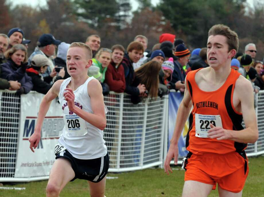 Aidan Tooker of Saratoga, left, and Stephen Booker of Bethlehem compete in the Class A State high school cross country championships on Saturday Nov. 9, 2013 in Queensbury, N.Y. Booker finished 5th and Tooker finished 6th. (Michael P. Farrell/Times Union) Photo: Michael P. Farrell / 00024515A