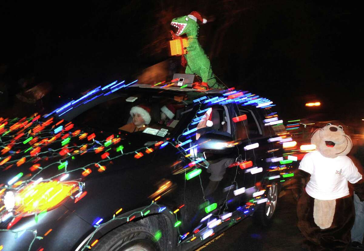Cars decorated for the holidays participate in the Town of Bethlehem Holiday Parade on Friday Dec. 6, 2013 in Delmar, N.Y. (Michael P. Farrell/Times Union)