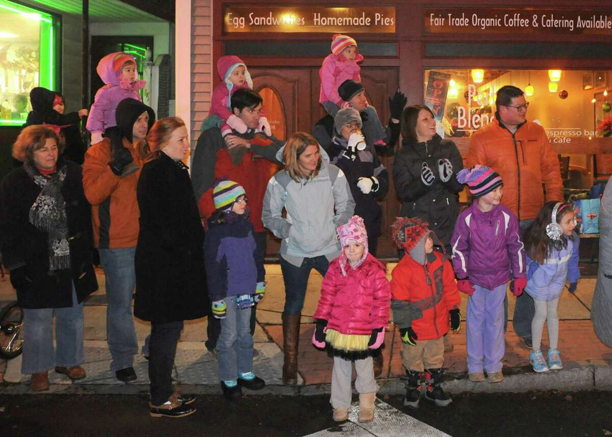 Families line Delaware Avenue to watch the Town of Bethlehem Holiday Parade on Friday Dec. 6, 2013 in Delmar, N.Y. (Michael P. Farrell/Times Union)
