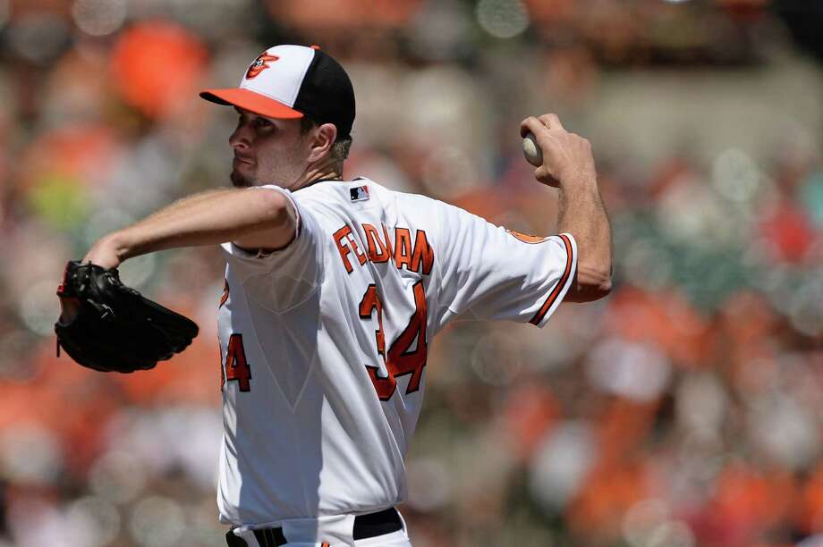 BALTIMORE, MD - AUGUST 25: Pitcher Scott Feldman #34 of the Baltimore Orioles pitches in the first inning against the Oakland Athletics at Oriole Park at Camden Yards on August 25, 2013 in Baltimore, Maryland. (Photo by Patrick Smith/Getty Images) Photo: Patrick Smith, Stringer / 2013 Getty Images