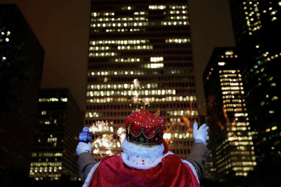 Lonnie Bernard, dressed as Santa Claus, watches the fireworks. Photo: © TODD SPOTH,  2013 / © TODD SPOTH, 2013