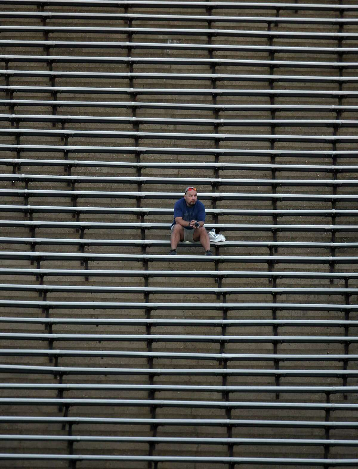 In 2012, A lonely fan watches the second half of a Conference USA football game between Rice and SMU. Questions surrounding the stadium's future are its lack of modern upgrades and the ability to fill the stands. Boosters and alumni are weighing ways to save the stadium.