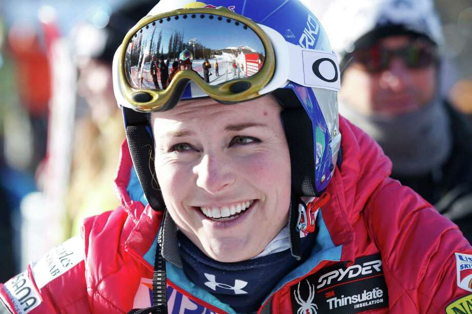 Lindsey Vonn, of the United States, reacts in the finish area following her run at the women's World Cup downhill ski race in Lake Louise, Alberta, Friday, Dec. 6, 2013.  (AP Photo/The Canadian Press, Jeff McIntosh) ORG XMIT: JMC211 Photo: Jeff McIntosh / The Canadian Press