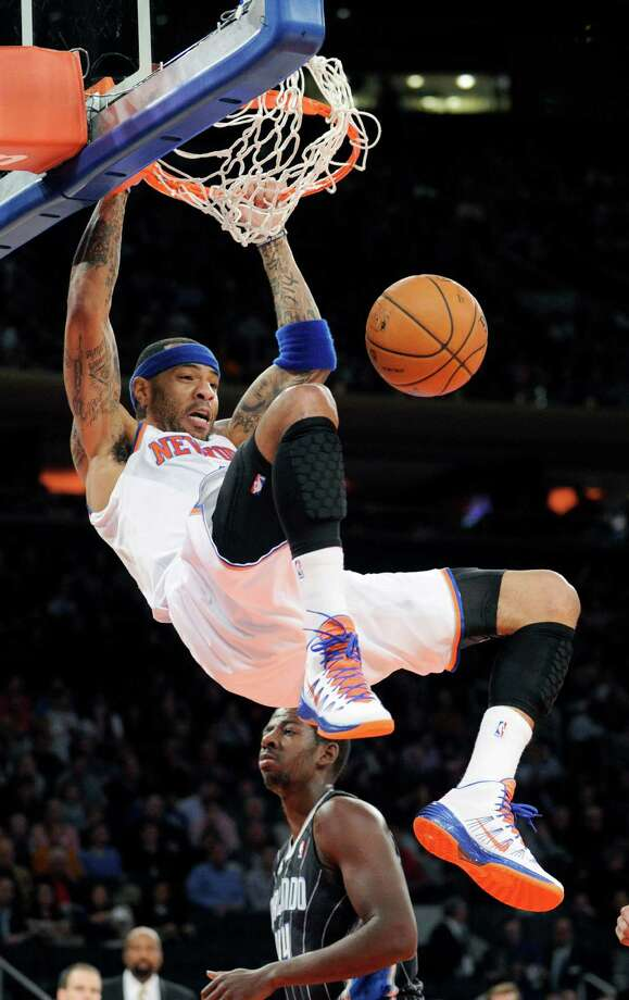 New York Knicks' Kenyon Martin dunks the ball during the second quarter of an NBA basketball game against the Orlando Magic, Friday, Dec. 6, 2013, at Madison Square Garden in New York. (AP Photo/Bill Kostroun) ORG XMIT: NYBK101 Photo: Bill Kostroun / FR51951 AP