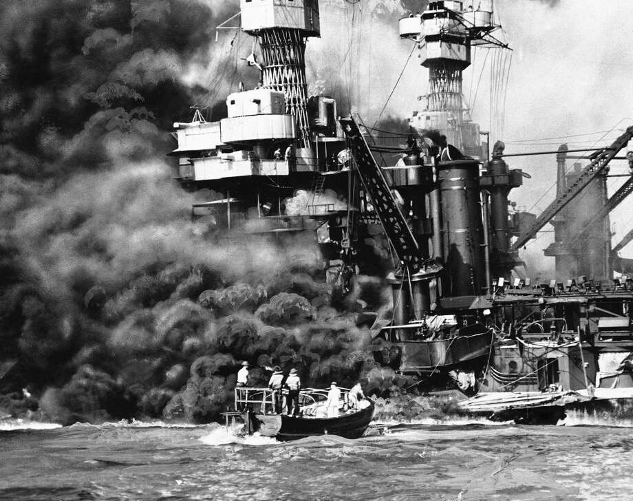 In this photo provided by the U.S. Navy, a Navy launch pulls up to the blazing USS West Virginia to rescue a sailor, Dec. 7, 1941, during the attack on Pearl Harbor Photo: Uncredited, AP Photo / A1941