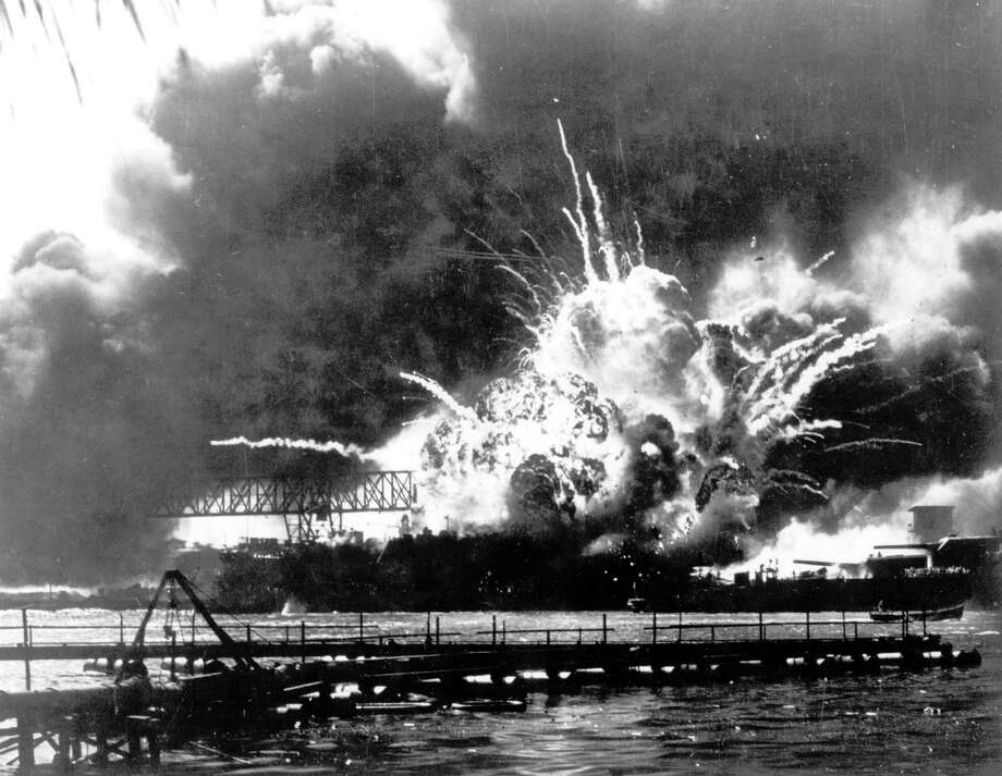 FILE - In this Dec. 7, 1941 file photo, the destroyer USS Shaw explodes after being hit by bombs during the Japanese surprise attack on Pearl Harbor, Hawaii. Wednesday marks the 70th anniversary of the attack that brought the United States into World War II. (AP File Photo) Photo: Anonymous, AP Photo / 1941 AP