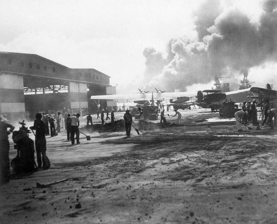 In this photo provided by the U.S. Navy, hanger No. 6 and the warm-up apron of the air station landing strip on Ford Island in Pearl Harbor, Hawaii shown during the attack, Dec. 7, 1941. Photo: Anonymous, AP Photo / AP1941