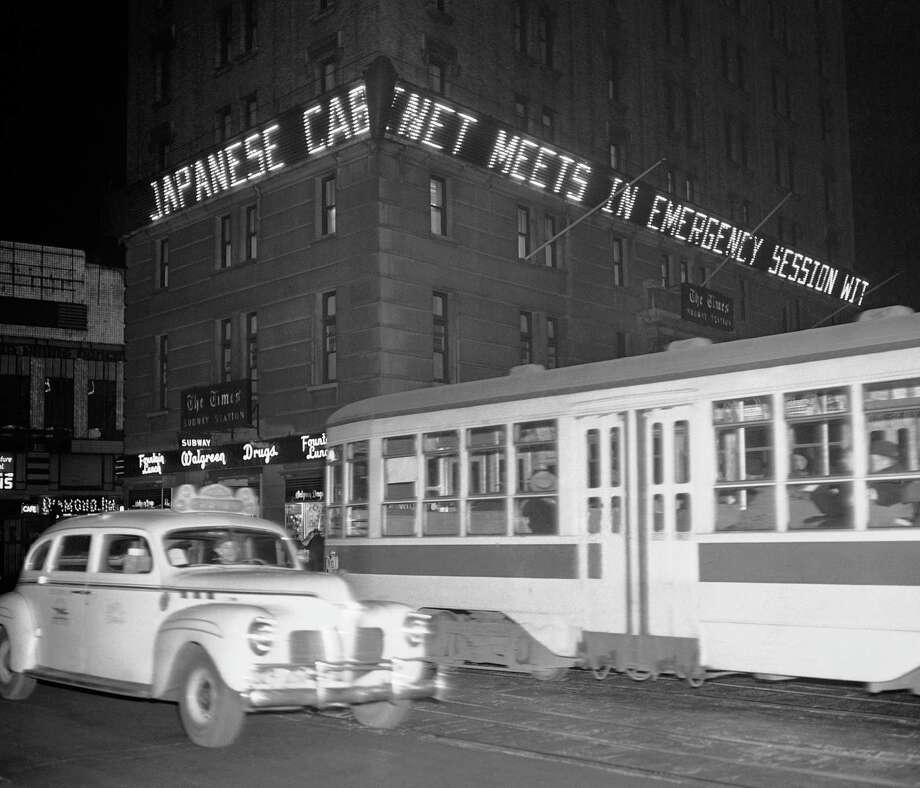 """Japanese cabinet meets in emergency session,"" is the bulletin shown in Times Square's news zipper in lights on the New York Times building, New York, Dec. 7, 1941. Photo: Robert Kradin, AP Photo / 1941 AP"