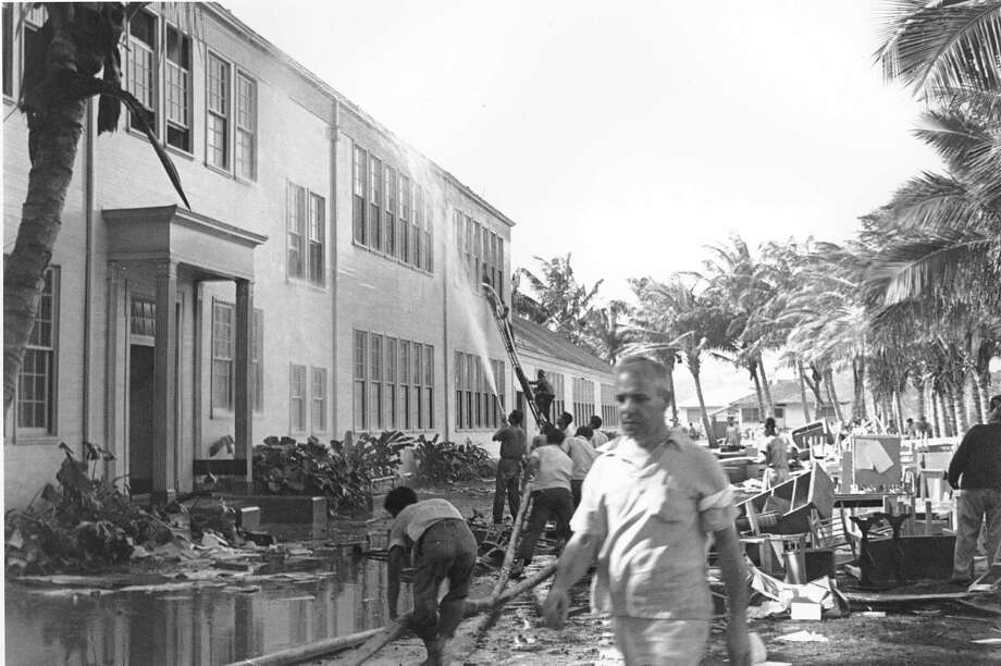 Rescue workers help evacuate the Lunalilo High School in Honolulu after the roof of the main building was hit by a bomb during the Japanese attack at Pearl Harbor, Hawaii in this Dec. 7, 1941 file photo. Photo: AP Photo / 1941 AP